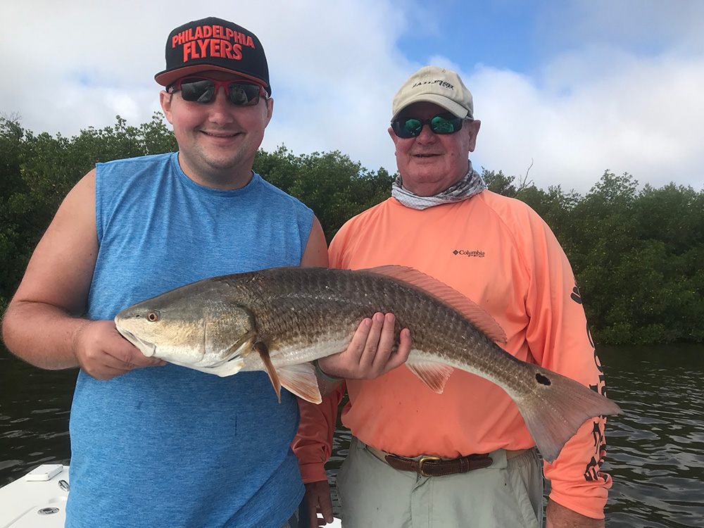 Captain Denny Pellegrino and grandson Jeremy with Redfish catch