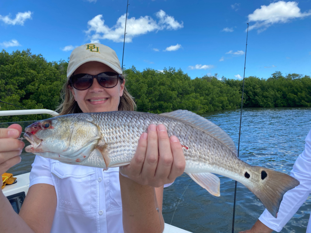 Staci with her Red Fish catch