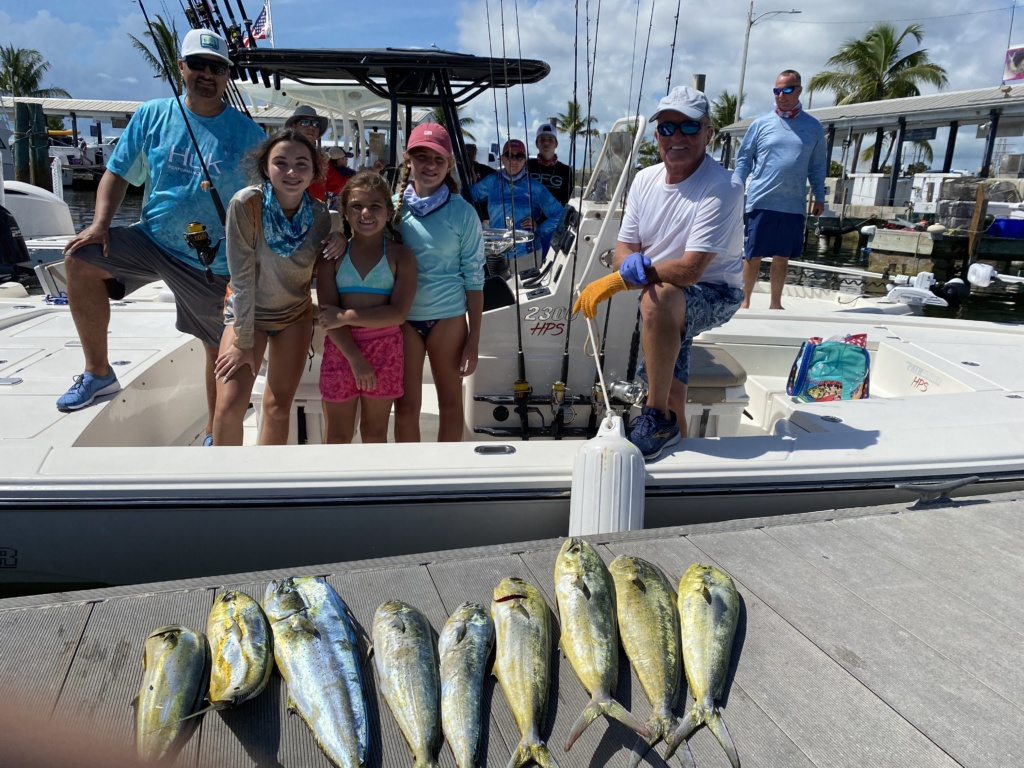 Terry with clients and their Mahi Mahi catches
