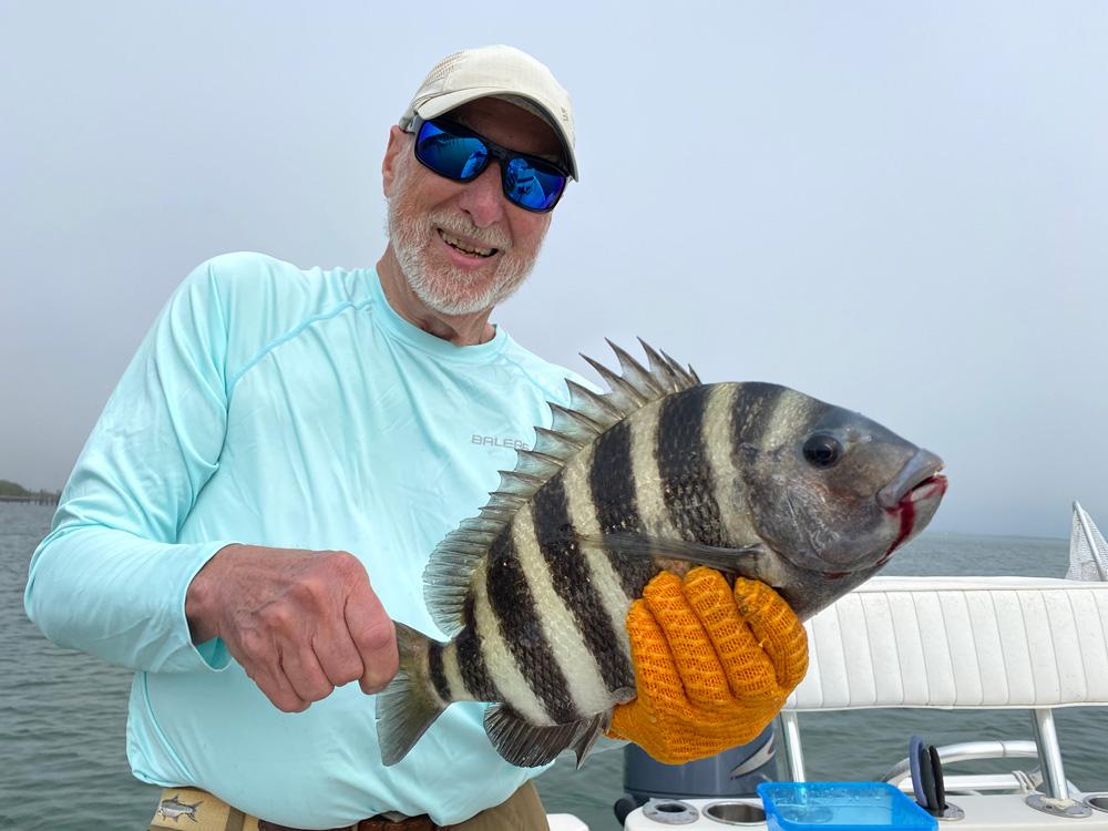 Gary Carlson holding his Sheepshead catch