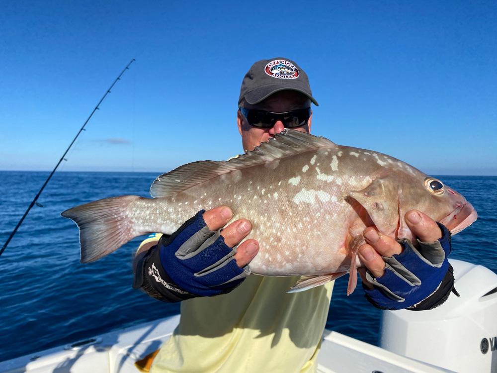 Man holding redfish he caught