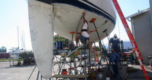 Sanding the bottom of a sail boat