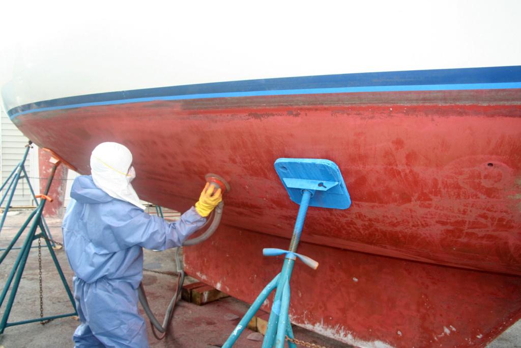Vacuum sanding boat bottom